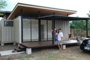 Building-House-from-Shipping-Containers-with-Glass-Window-and-Black-Car-min